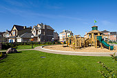 Several suburban houses with wooden playground