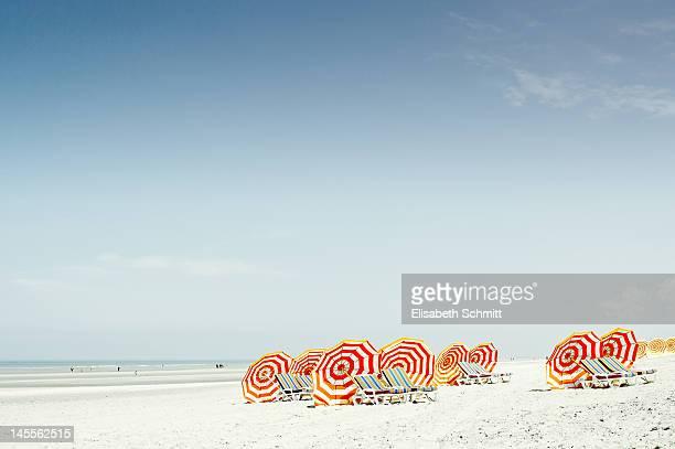 Several sunshades and beachchairs at beach