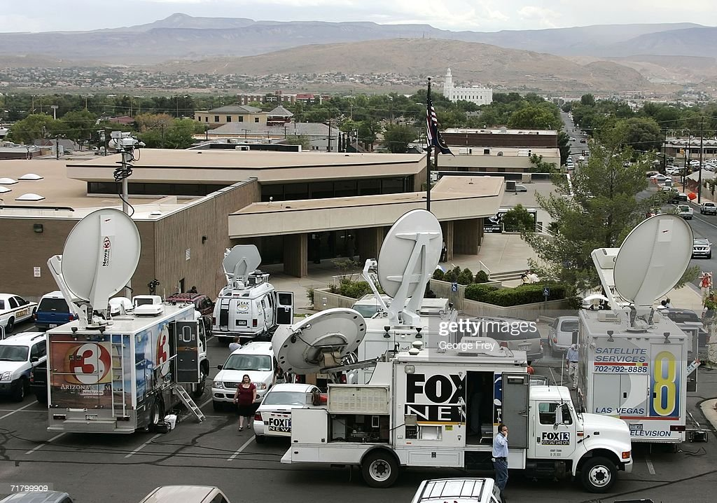 Several television trucks are parked outside the 5th Judicial District Courthouse for the first court hearing for Fundamentalist Church of Jesus...