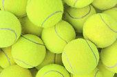 Lots of vibrant tennis balls.