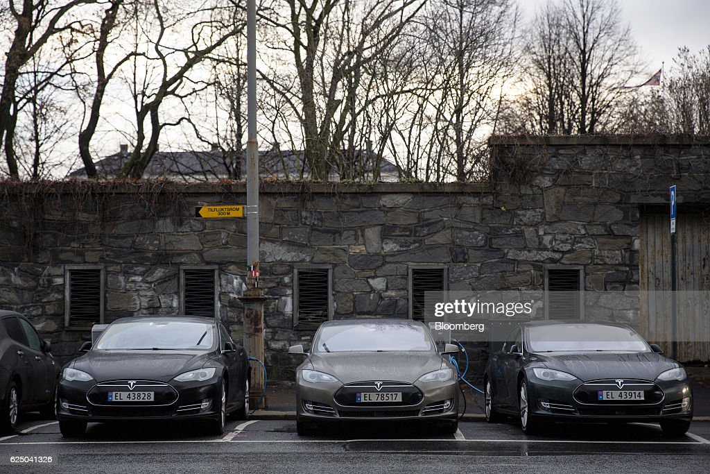 Several Tesla Motors Inc. Model S electric vehicles (EV) sit parked at charging stations at Kongens gate near Akershus festning in Oslo, Norway, on Monday, Nov. 21, 2016. The International Energy Agency forecasts that global gasoline consumption has all but peaked as more efficient cars and the advent of electric vehicles from new players such as Tesla Motors Inc. halt demand growth in the next 25 years. Photographer: Fredrik Bjerknes/Bloomberg via Getty Images