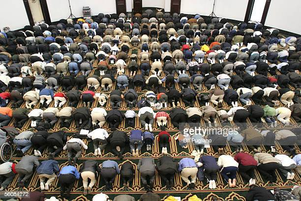 Several thousand Muslims gather in prayer at the Islamic Center of America to celebrate Eid alFitr November 4 2005 in Dearborn Michigan The feast...