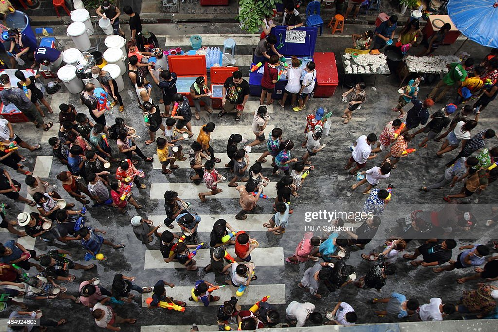 Several thousand people take part in a water fight during the Songkran water festival in Silom Road in Bangkok. The Songkran Festival runs from 13 to 15 April with people celebrating in various ways, including splashing water at each other for luck.