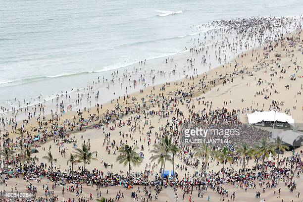 Several thousands of local revellers and holidaymakers gather on the South Pier Beach during Boxing Day festivities in Durban on December 26 2014 The...