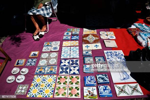 Several tiles are displayed for sale at 'Feira da Ladra' market in Lisbon on July 1 2017 They used to adorn everything from park benches to...