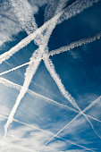 Several vapor trails crossing in the sky
