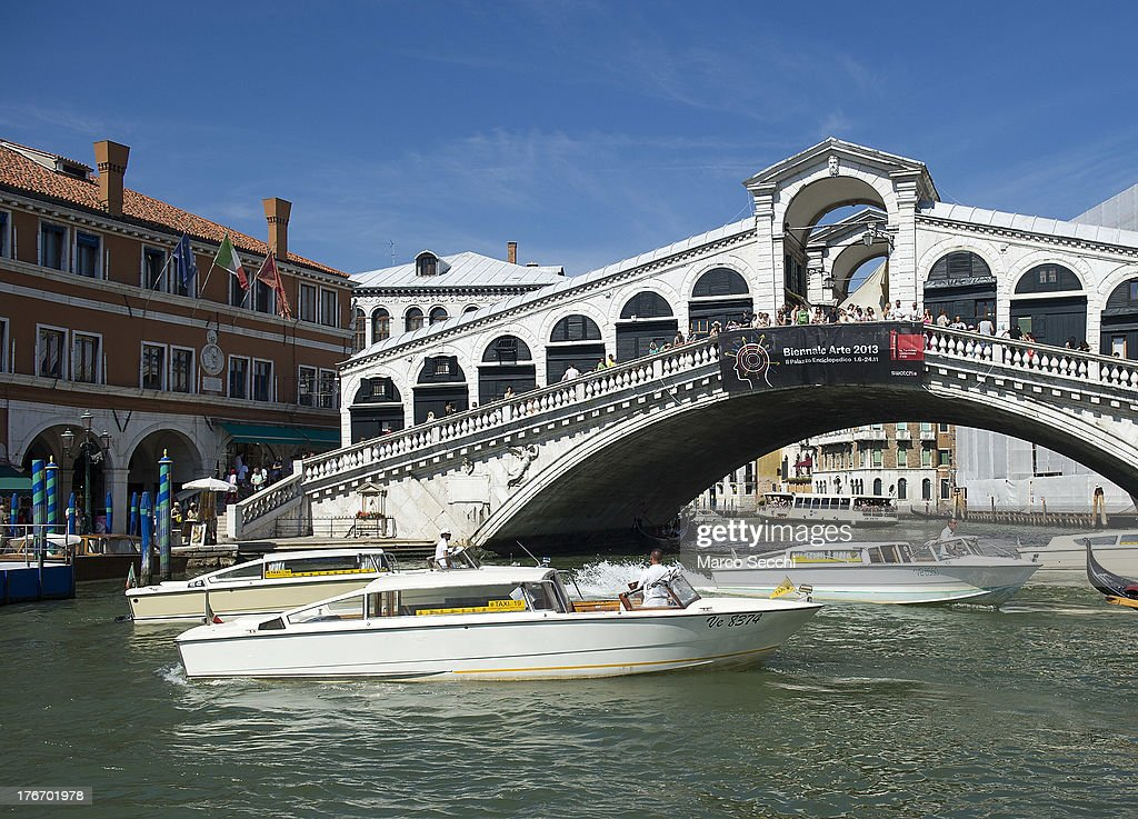 Several water taxi try to park under the Rialto Bridge just in front of the place where today a German tourist was crashed to death on August 17, 2013 in Venice, Italy. A German tourist was crushed to death on Saturday when the gondola he was boarding collided with a waterbus (Vaporetto) along Venice's Grand Canal.