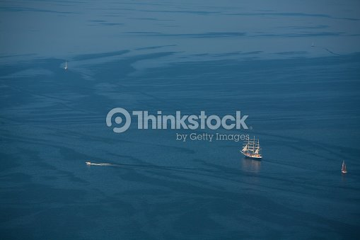Several Yachts And Sailboats Go To Sea Under Sail View From