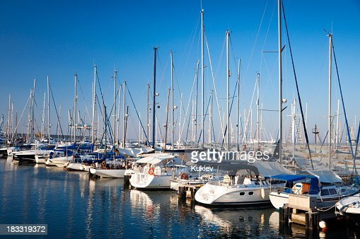 Several yachts docked at the harbor