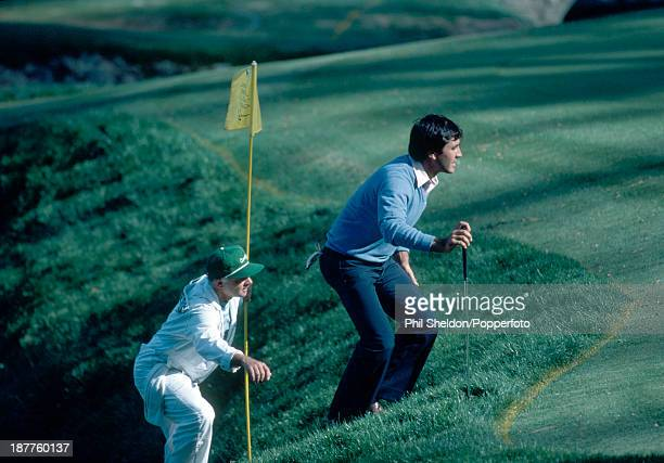 Severiano Ballesteros of Spain and his caddie lining up a putt during the US Masters Golf Tournament held at the Augusta National Golf Club Georgia...