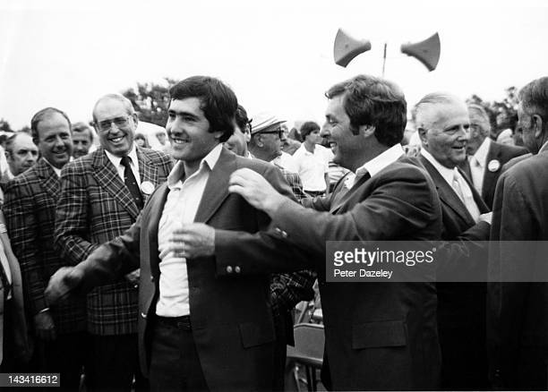 Severiano Ballesteros of Spain receives the Green Jacket from the 1979 champion Fuzzy Zoeller of the USA after the final round of the 1980 Masters...