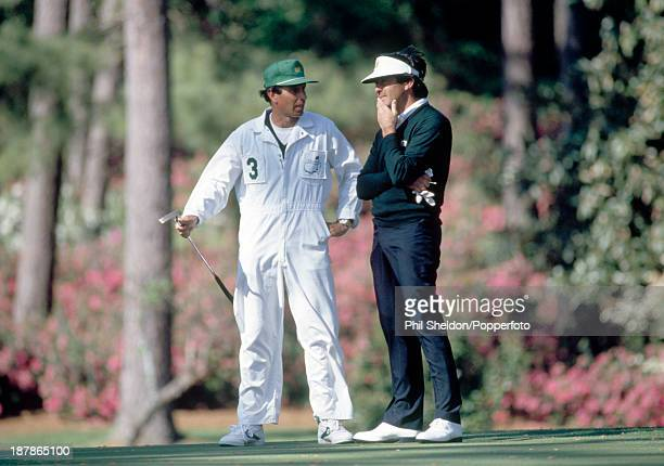 Severiano Ballesteros of Spain talking with his caddie during the US Masters Golf Tournament held at the Augusta National Golf Club Georgia circa...