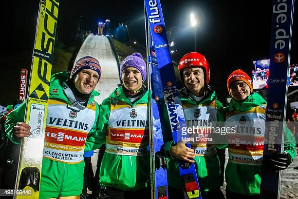Severin Freund Andreas Wellinger Andreas Wank and Richard Freitag from Germany pose for photographers as they won the team competition during the FIS...