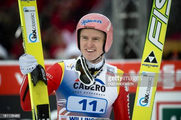 Severin Freund of Germany reacts after his final jump placing his team third during the FIS Ski Jumping World Cup team competition on the...
