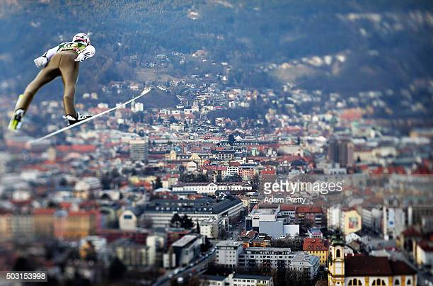 Severin Freund of Germany soars over Innsbruck during his qualification jump on Day 1 of the Innsbruck Four Hills Tournament on January 2 2016 in...