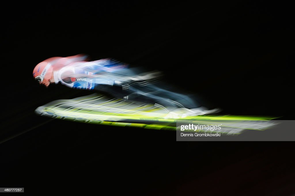 Severin Freund of Germany soars through the air during his first trial jump on day 1 of the 62nd Four Hills Tournament event at...