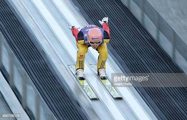 Severin Freund of Germany soars through the air during his practice jump on Day 2 of the 65th Four Hills Tournament ski jumping event on January 1...