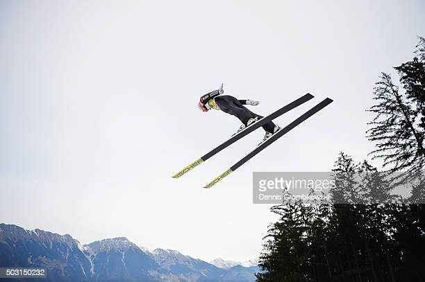 Severin Freund of Germany soars through the air during his training jump on day 1 of the 64th Four Hills Tournament ski jumping event on January 2...