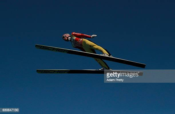 Severin Freund of Germany soars through the air during his training jump on Day 1 of the 65th Four Hills Tournament ski jumping event on December 29...