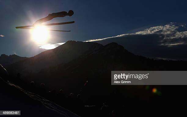 Severin Freund of Germany soars through the air during the training round on day 1 of the Four Hills Tournament Ski Jumping event at...