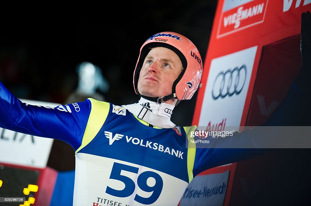 Severin Freund raises arms after his jump in the Large Hill Individual competition on day one of the FIS Ski Jumping World Cup on February 7 2015 in...