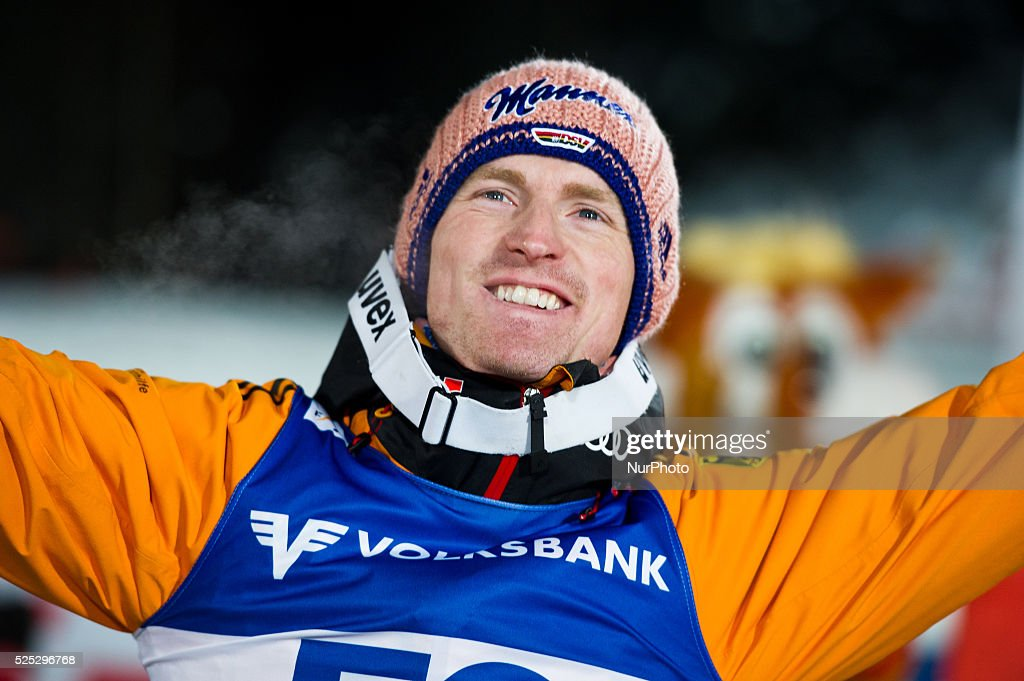 Severin Freund raises hands after winning at the Large Hill Individual competition on day one of the FIS Ski Jumping World Cup on February 7 2015 in...