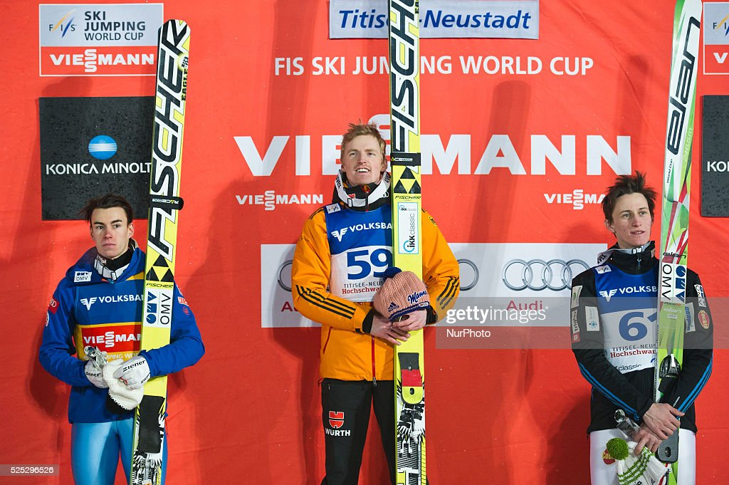 Severin Freund Stefan Kraft and Peter Prevc on the winners podium after the Large Hill Individual competition on day one of the FIS Ski Jumping World...