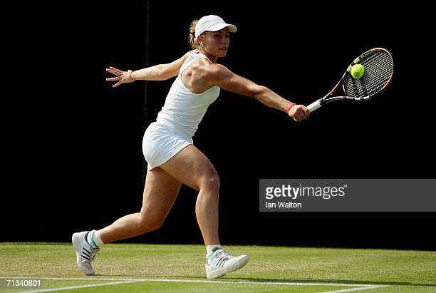 Severine Bremond of France returns a backhand to Gisela Dulko of Argentina during day five of the Wimbledon Lawn Tennis Championships at the All...