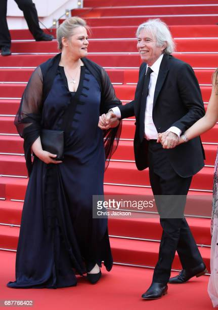 Severine Caneele and director Jacques Doillon depart after the 'Rodin' screening during the 70th annual Cannes Film Festival at Palais des Festivals...