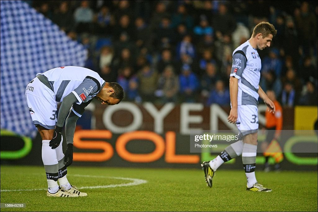 Severino da Silva Robson - Gunther Vanaudenaerde of OHL in action during the Jupiler League match between KRC Genk and Oud Heverlee Leuven OHL on November 25, 2012 in Genk, Belgium.