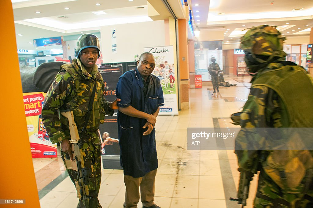A severly wounded man is rescued by Kenyan troops at the Westgate Mall on September 21 2013 in Nairobi Kenyan troops were locked in a fierce...