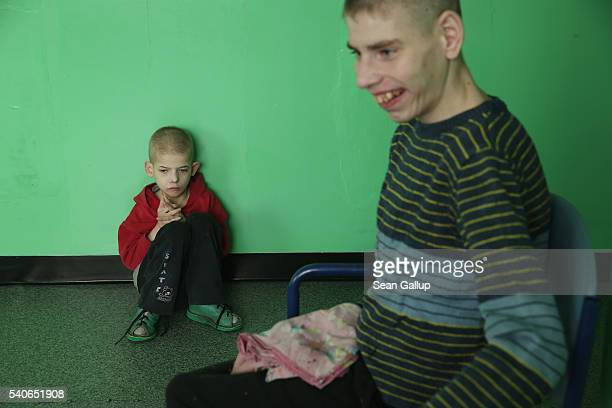 Severlyhandicapped boys sit in their wing at the Vesnova Home for Invalid Children on April 3 2016 in Vesnova village near Glusk Belarus...