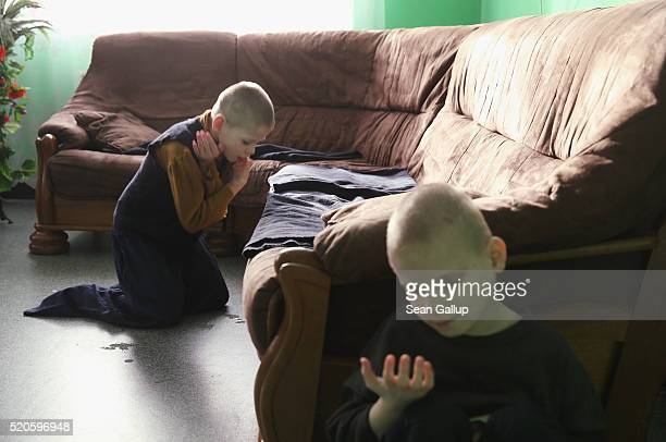 Severlyhandicapped boys sit on the floor in their wing at the Vesnova Home for Invalid Children on April 3 2016 in Vesnova village near Glusk Belarus...