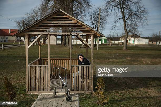 A severlyhandicapped young man sits in a gazebo near the independent living quarters at the Vesnova Home for Invalid Children on April 3 2016 in...
