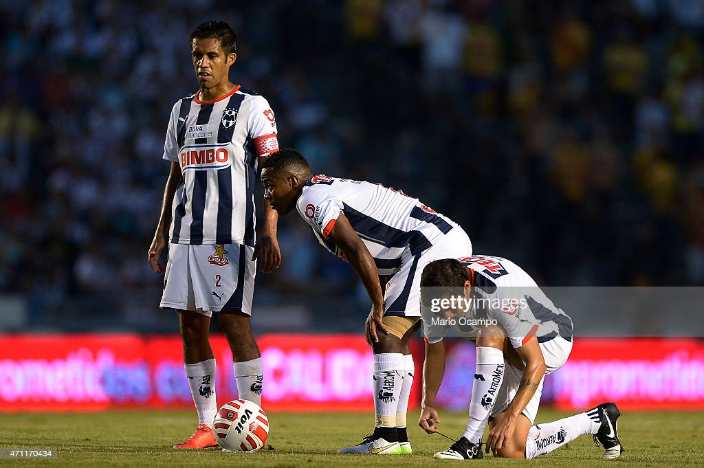 Severo Meza Dorlan Pabon and Neri Cardozo of Monterrey prepare for a free kick during a match between Monterrey and Morelia as part of 15th round of...