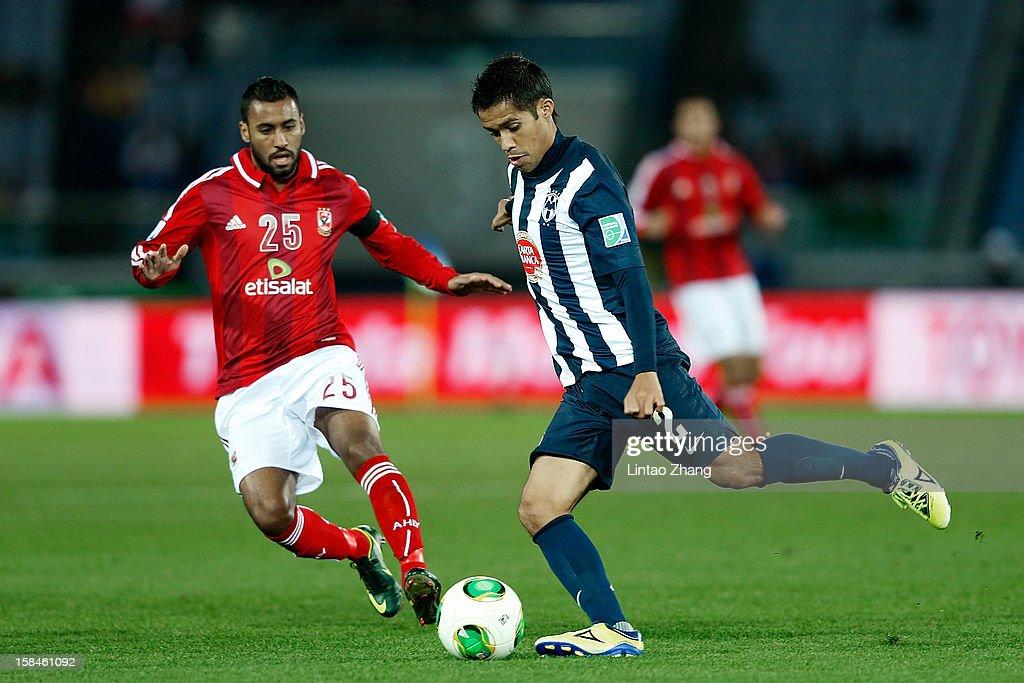 Severo Meza (R) of Monterrey challenges Hossam Ashour of Al-Ahly SC during the FIFA Club World Cup 3rd Place Match between Al-Ahly SC and CF Monterrey at International Stadium Yokohama on December 16, 2012 in Yokohama, Japan.