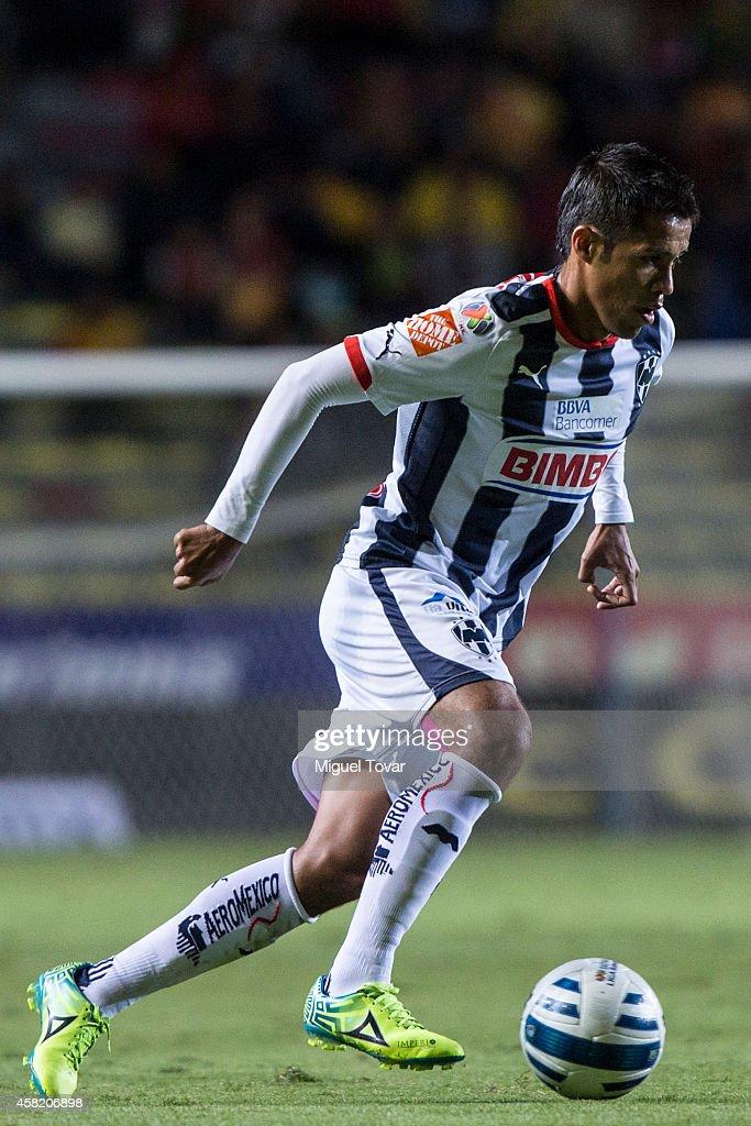 Severo Meza of Monterrey drives the ball during a match between Morelia and Monterrey as part of 15th round Apertura 2014 Liga MX at Jose Maria...