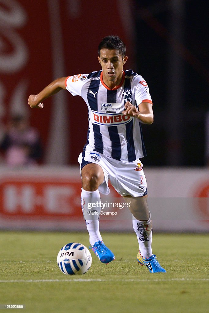 Severo Meza of Monterrey drives the ball during a match between Monterrey and Chiapas as part of 16th round Apertura 2014 Liga MX at Tecnologico...