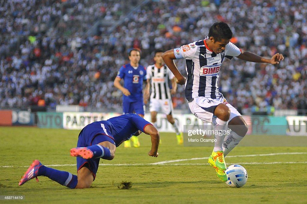 Severo Meza of Monterrey evades a Cruz Azul's player during a match between Monterrey and Cruz Azul as part of 5th round Apertura 2014 Liga MX at...