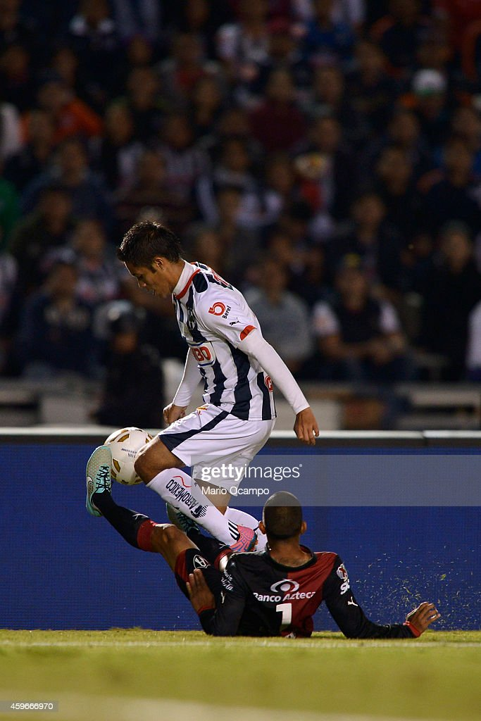 Severo Meza of Monterrey fights for the ball with Edgar Castillo of Atlas during a quarterfinal first leg match between Monterrey and Atlas as part...