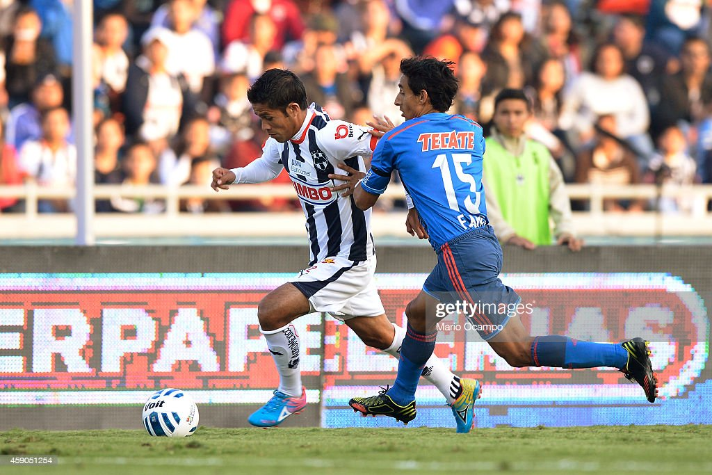 Severo Meza of Monterrey fights for the ball with Fernando Arce of Chivas during a match between Monterrey and Chivas as part of 8th round Apertura...