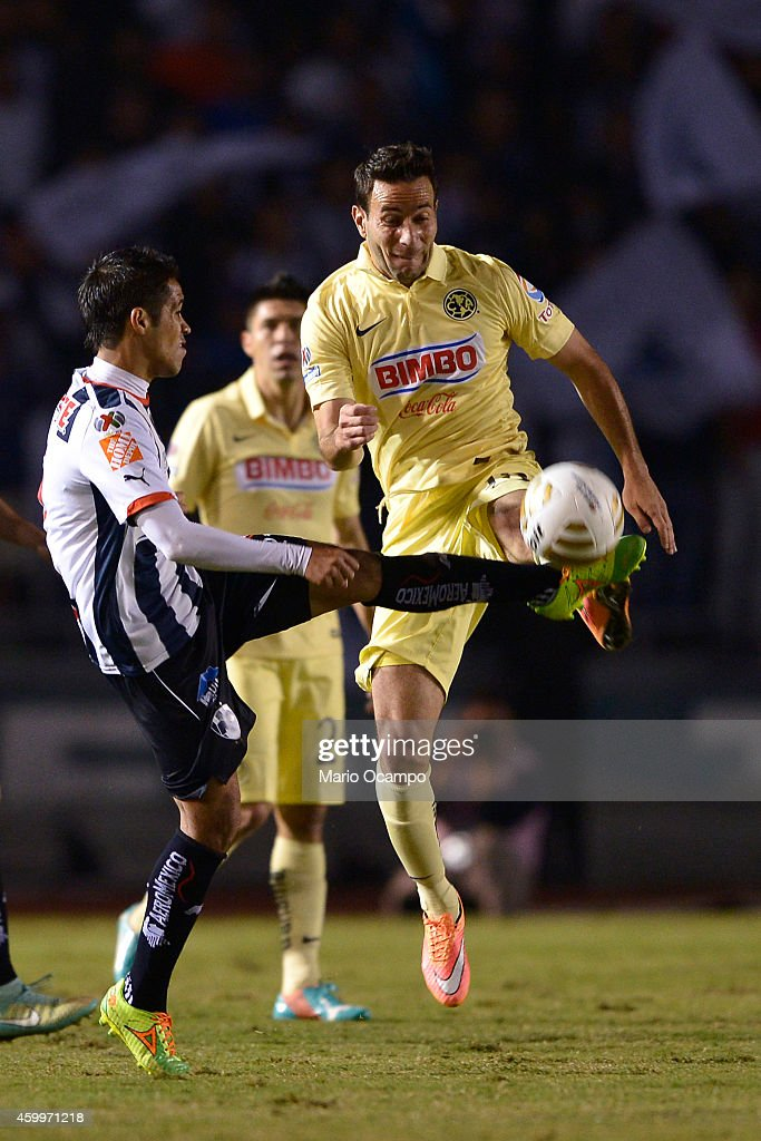 Severo Meza of Monterrey fights for the ball with Luis Gabriel Rey of America during a semifinal first leg match between Monterrey and America as...