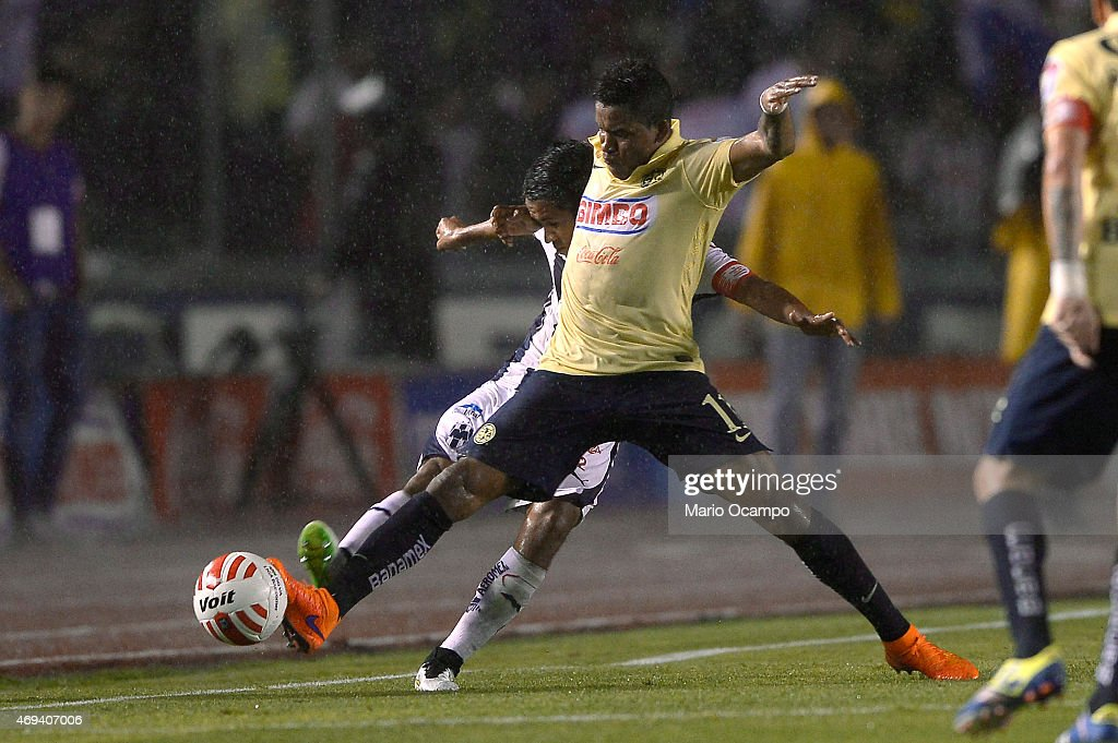 Severo Meza of Monterrey fights for the ball with Michael Arroyo of America during a match between Monterrey and America as part of 13th round of...