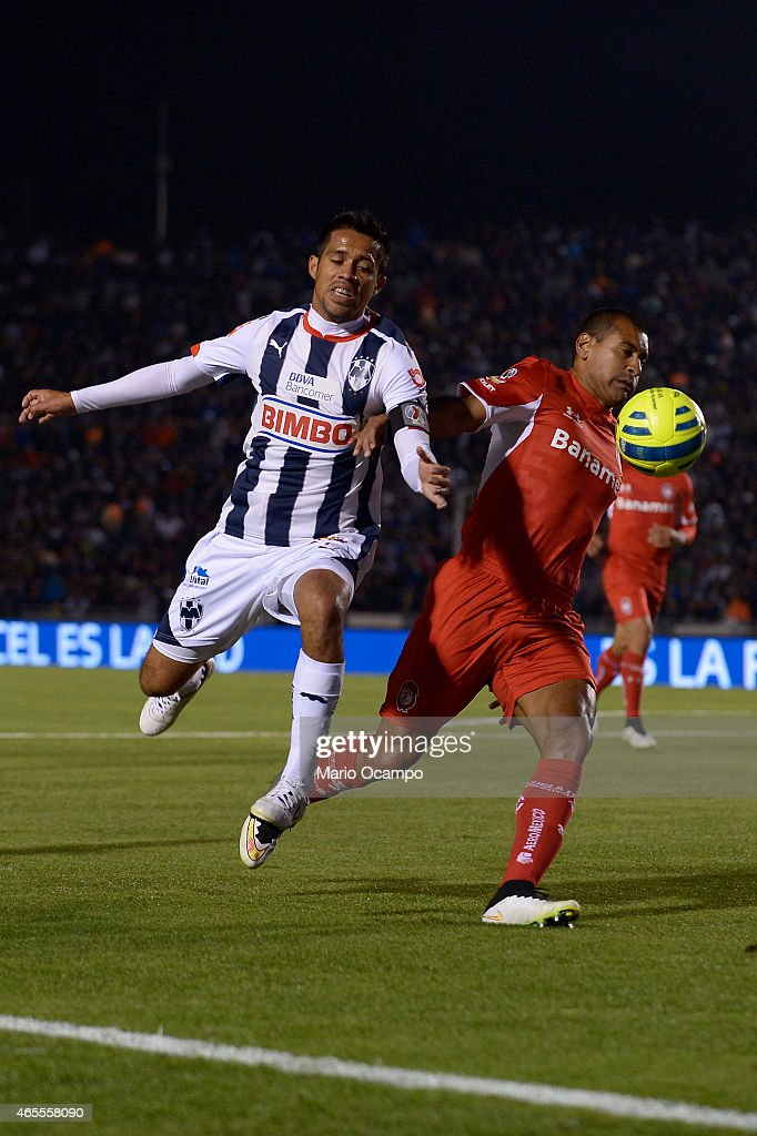 Severo Meza of Monterrey fights for the ball with Paulo Da Silva of Toluca during a match between Monterrey and Toluca as part of 9th round Clausura...