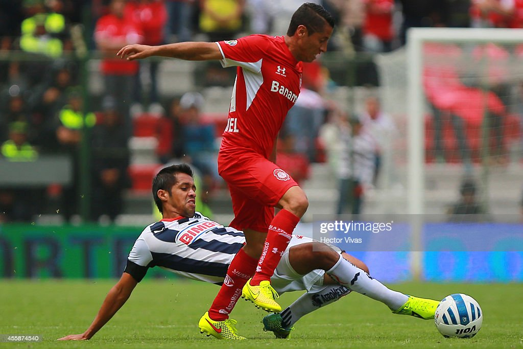 Severo Meza of Monterrey struggles for the ball with Carlos Esquivel of Toluca during a match between Toluca and Monterrey as part of 9th round...