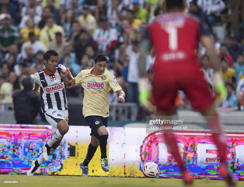 Severo Meza of Monterrey vies for the ball with Rubens Sambueza of America during their 2015 Mexican Clausura tournament football match in Monterrey...