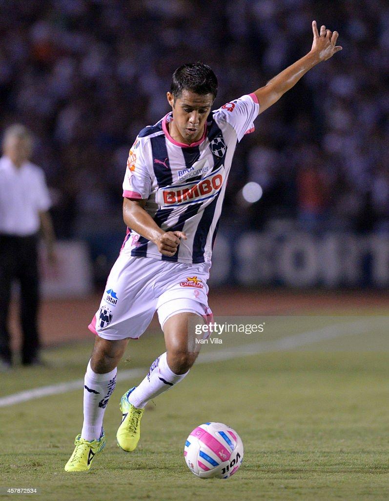Severo Meza prepares a shot during a match between Monterrey and Tigres UANL as part of 14th round Apertura 2014 Liga MX at Tecnologico Stadium on...