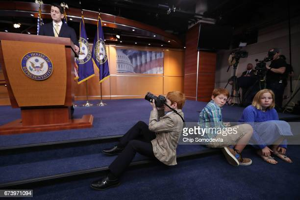 Severyearold Archer Somodevilla photographs Speaker of the House Paul Ryan during Ryan's weekly news conference at the US Capitol Visitors Center...