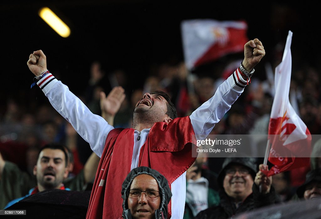 A Sevilla fan celebrates after they scored their 3rd goal in the UEFA Europa League Semi Final second leg match between Sevilla and Shakhtar Donetsk at the Sanchez Pizjuan stadium on May 5, 2016 in Seville, Spain.