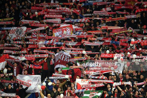Sevilla fans cheer on their team during the UEFA Champions League Round of 16 second leg match between Leicester City and Sevilla FC at The King...